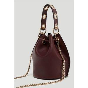 Zara burgundy and gold bucket bag